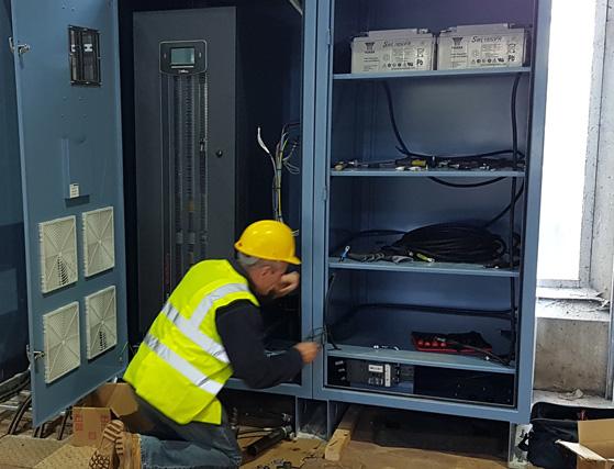 Engineer installing a UPS